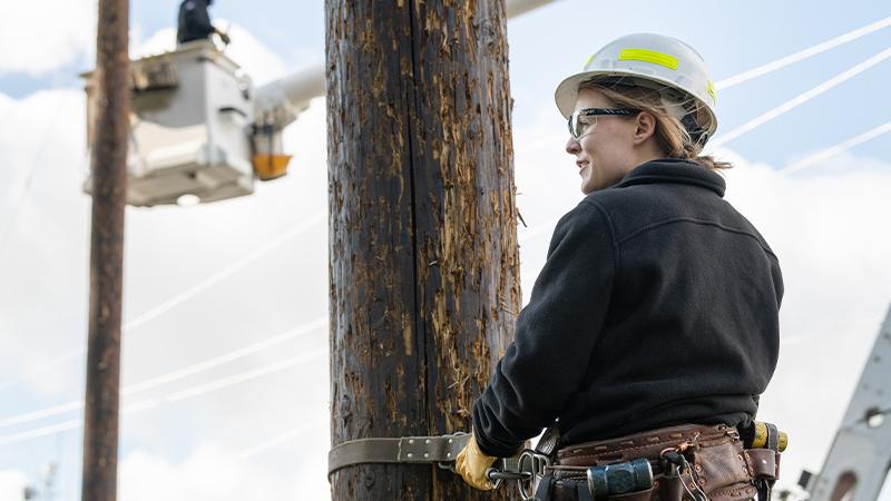 woman lineworker on pole